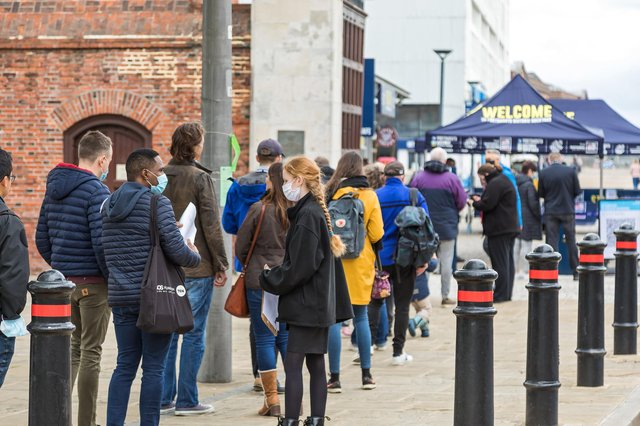 Queues form outside the Historic Dockyard on the first weekend after lockdown. Picture: Mike Cooter (220521)