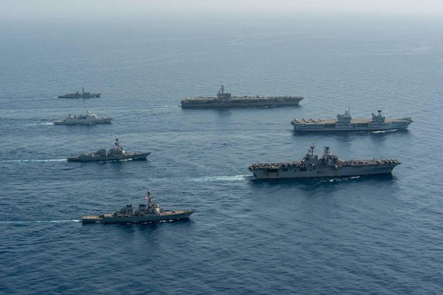 Ships of the UK Carrier Strike Group, USS Ronald Reagan Carrier Strike Group, and Iwo Jima Amphibious Ready Group operate in formation in the Gulf of Aden, July 12. UK, Dutch and U.S. naval forces conducted an integrated at-sea exercise designed to enhance maritime interoperability and demonstrate naval integration through a series of training scenarios. (U.S. Navy photo by Mass Communication Specialist Seaman Gray Gibson)