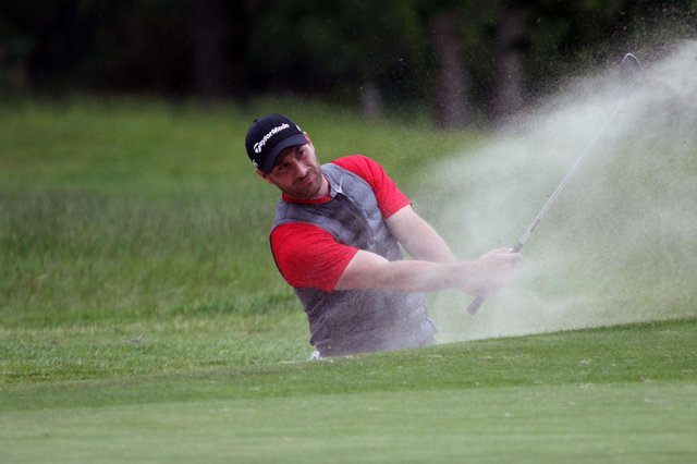Hayling's Toby Burden splashes out of a greenside bunker during the final of the 116th Hampshire, Isle of Wight and Channel Islands Amateur Championship, against La Moye's Jo Hacker at North Hants GC. Picture: ANDREW GRIFFIN / AMG PICTURES