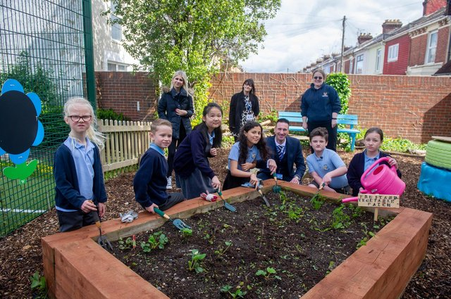 Megan Patten, Kell Swift and Kelly Prior with some of Copnor School pupils and headteacher, Matt Johnson, at the transformed garden at Copnor Primary School. Picture: Habibur Rahman