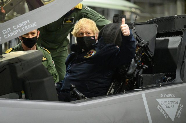 Prime Minister Boris Johnson sits in the cockpit of an Lockheed Martin F-35 Lightning II during a visit to HMS Queen Elizabeth aircraft carrier in Portsmouth this month. (Photo by Leon Neal - WPA Pool/Getty Images)