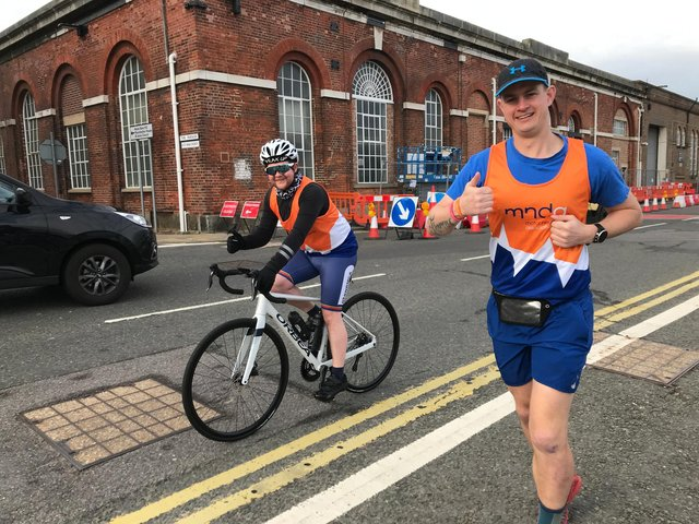 Able Rate Eddy Eggleton, right,is running seven marathons in seven days this week in a bid to raise money for the Motor Neurone Disease Association. He is pictured with Tom Galloway, who is cycling next to him as his support.  Photo: Royal Navy