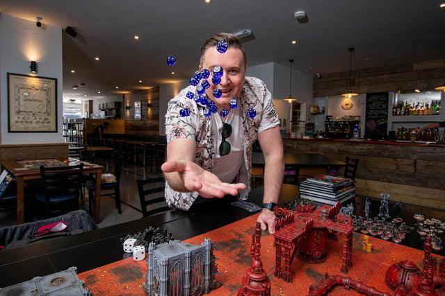 Dice reopened in Albert Road, Southsea, on May 18, 2021. Co-owner, Lee Purslow playing Warhammer 40,000. Picture: Habibur Rahman