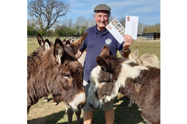 Hayling Island Donkey Sanctuary received a donation from patron and good friend John 'Boycie' Challis and TV co star Sue 'Marlene' Holderness to boost their fundraising. Pictured: Volunteer Phill Upshall with a couple of donkeys and the signed items