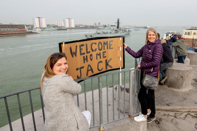 Georgia Davis and Michelle Feltham on the Round Tower, Old Portsmouth welcoming HMS Lancaster as it arrives in Portsmouth. Picture: Habibur Rahman