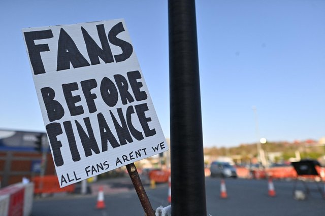 A picture shows a placard with a message against plans for a European Super League outside Elland Road ahead of the English Premier League football match between Leeds United and Liverpool in Leeds, northern England, on April 19, 2021. Picture: PAUL ELLIS/AFP via Getty Images