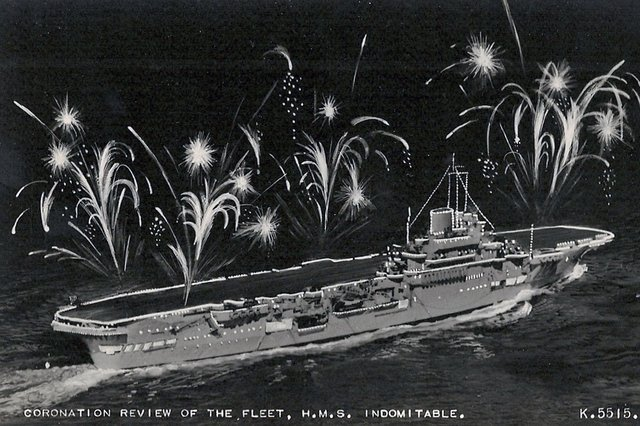 HMS Indomitable lit up for the coronation fleet review at Spithead in 1953. Picture: Avaon Davies