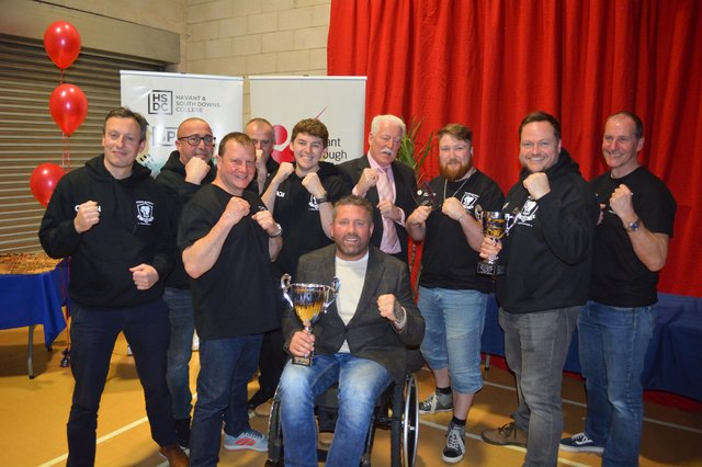 Knox White with the trophy and Heart of Hayling Boxing Club members after they had won the Club of the Year award in the annual Havant Borough Council Sports Awards.