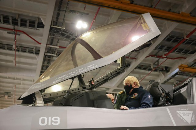 Boris Johnson pictured inside the cockpit of one of the embarked F-35 stealth jets.  Picture by Andrew Parsons / No 10 Downing Street