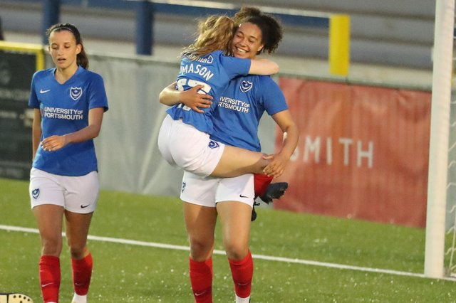 Abi Mason jumps on goalscorer Jazz Younger after she netted her first of two goals against AFC Portchester Ladies. Picture: Dave Haines
