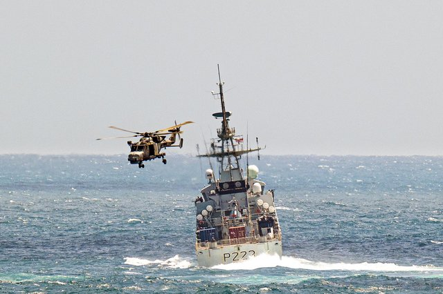 A Wildcat helicopter from RFA Wave Knight passed over HMS Medway during training in the Caribbean. Picture: The Royal Navy