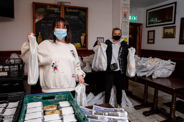 Jeanette Warren with Ashleigh Lane preparing for their final delivery on Friday 12 March 2021 inside The Lady Hamilton, The Hard, Portsmouth.  Picture: Habibur Rahman