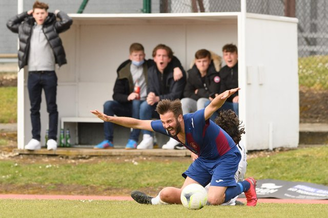 Dec Seiden is fouled during US Portsmouth's semi-final loss to Binfield. Picture: Keith Woodland