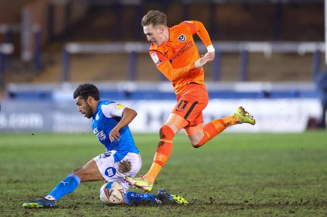Ronan Curtis battles with Nathan Thompson during the 1-0 defeat at Peterborough - with Joe Gallen praising the Pompey commitment. Picture: Nigel Keene/ProSportsImages