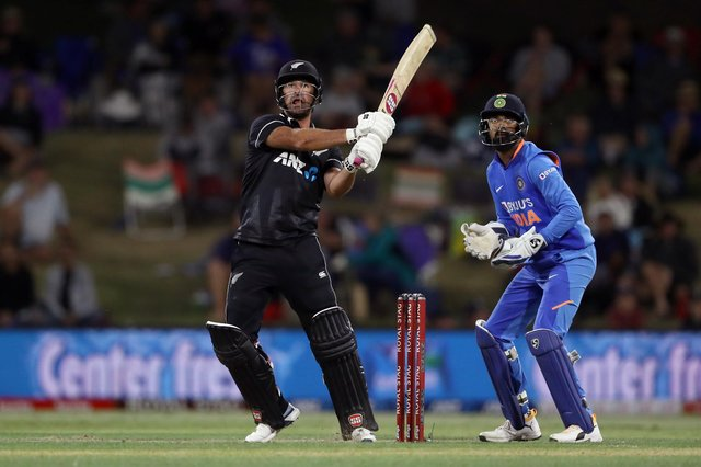 New Hampshire signing Colin de Grandhomme hits out in a T20 international for New Zealand. Photo by Hannah Peters/Getty Images.