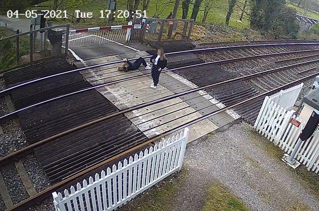 Girl pictured lying down on railway tracks near Horsham. Picture: Network Rail