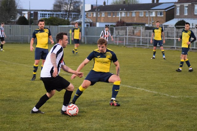 Jake Knight, foreground right against Hayling United last night, is still protecting an unbeaten record after Moneyfields Reserves' opening four L4 Teamwear Challenge Cup ties against higher division opponents. Picture: Dan (JMA Media).