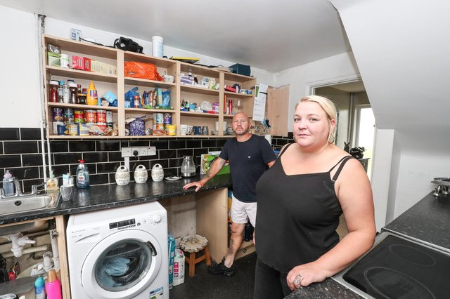 Donna Whitwick and her husband Neil in their kitchen which is in need of repair. Donna says she has been waiting for over a year for her housing association to fix problems in her house. Picture: Stuart Martin (220421-7042)