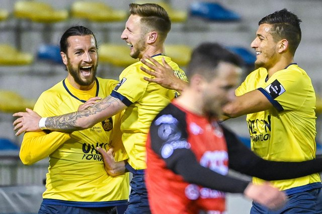 Christian Burgess, left, celebrates with his Royale Union Saint-Gilloise team-mates after scoring against RFC Seraing,  Picture:  LAURIE DIEFFEMBACQ/BELGA MAG/AFP via Getty Images