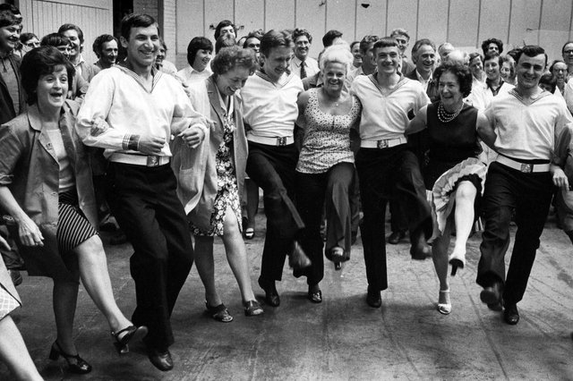 Workers at the Metal Box factory at Copnor introducing Russian sailors from the Soviet warship Obraztsovy to an English knees-up, 1976. Picture: The News PP5040