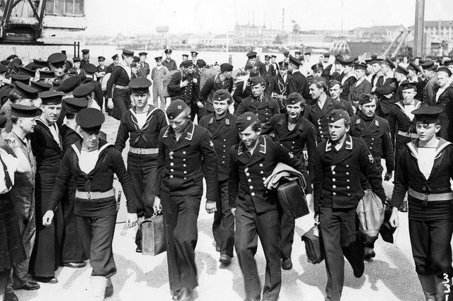 Crews of German E-boats march away under naval escort at Gosport, 1945. Picture: The News PP4520