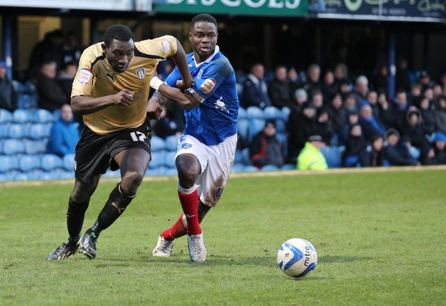 Sam Sodje tussles with Colchester's Jabo Ibehre on his Pompey debut at Fratton Park in February 2013. Picture: Barry Zee
