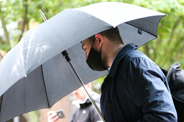 Former PCSO Joshua Fitzjohn leaves Portsmouth Crown Court wth an umbrella having being sentenced for coercive control of his wife (jpns 180621-15)