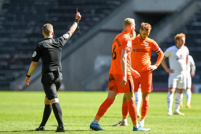 Portsmouth FC defender Jack Whatmough (6)shown a red card, sent off during the EFL Sky Bet League 1 match between Milton Keynes Dons and Portsmouth at stadium:mk, Milton Keynes, England on 17 April 2021.