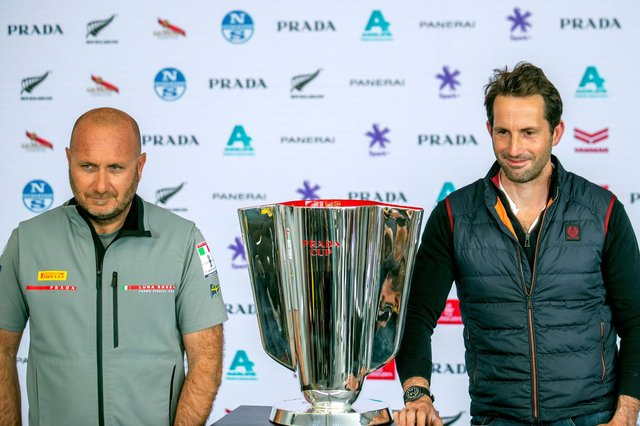 Team Ineos skipper Sir Ben Ainslie, right, with Luna Rossa team director Max Sirena with the Prada Cup at a press conference this week. Photo by Gilles Martin-Raget / AFP via Getty Images.