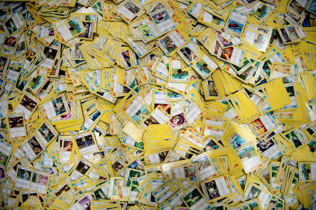 A huge stack of Pokemon cards. Photo by Brendan Smialowski / AFP via Getty Images