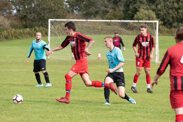Horndean (red/black) in Mid-Solent League action against Burrfields in the 2019/20 season. Picture: Duncan Shepherd
