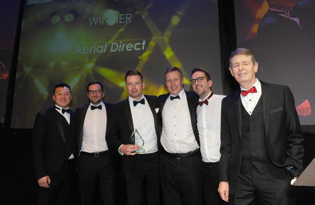 Pictured is: (right) Bill Moulsdale from sponsor Giant Leap Video & Photography with winners of the Large Business of the Year 2020 Award Aerial Direct. Picture: Sarah Standing (210220-8429)