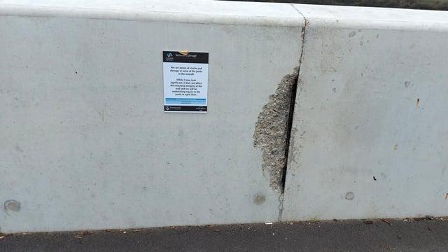 Damage to the sea defences at Tipner Lake