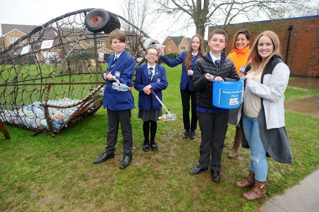 Students from Cams Hill School in Fareham, are working with the Gosport and Fareham Wombles as part of a litter campaign.Pictured is: (l-r) Kyle Robinson (13), Megan Beresford (11), Jessica Davies (14) and Cole McIntosh (12) with assistant headteacher Tanya Noble and Steph Suter from Gosport and Fareham Wombles.Picture: Sarah Standing (050320-9552)