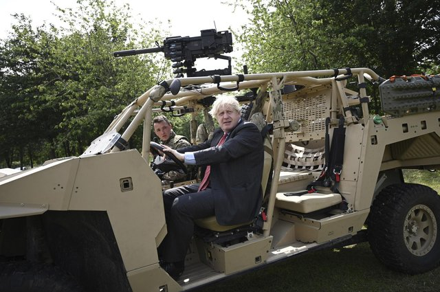 Britain's Prime Minister Boris Johnson poses in an armoured vehicle of the new Ranger Regiment during a visit to mark Armed Forces Week, at the Aldershot Garrison in Aldershot, England. Picture: Daniel Leal-Olivas/Pool via PA.