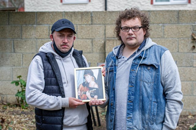Sonny and Harry Shaw with a picture of their mother, Dee at their home in Cosham. Picture: Habibur Rahman