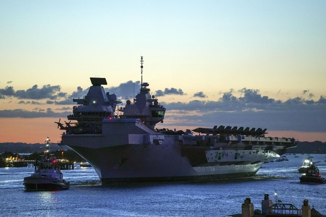 HMS Queen Elizabeth departs HM Naval Base, Portsmouth, for her maiden deployment to lead the UK Carrier Strike Group on a 28-week operational deployment travelling over 26,000 nautical miles from the Mediterranean to the Philippine Sea. Picture date: Saturday May 22, 2021.