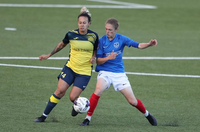 Sokhara Goodall, left, battles Pompey Women's Shannon Albuery for the ball. Picture: Dave Haines