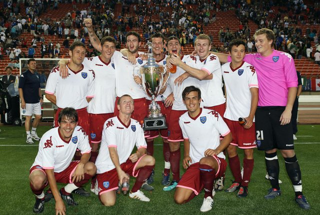 Michael Brown, David Nugent and Marc Wilson are joined by Pompey youngsters including Matt Ritchie, Joel Ward and Marlon Pack after winning the Edmonton Cup - part of their farcical pre-season tour of North America in 2010. Picture: Joe Pepler