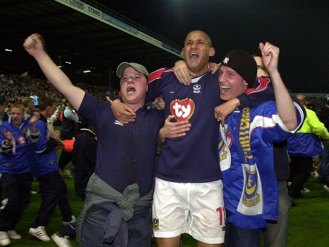 Nigel Quashie celebrates with Pompey fans after sealing promotion to the Premier League in April 2003. Picture: Jonathan Brady