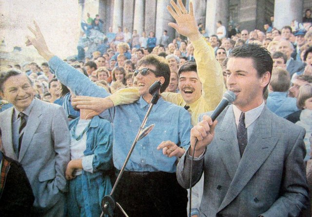 Paul Mariner, centre, celebrates Pompey promotion at the end of the 1986-87 season at Guildhall Square with team-mates Mick Quinn and Mick Kennedy.
