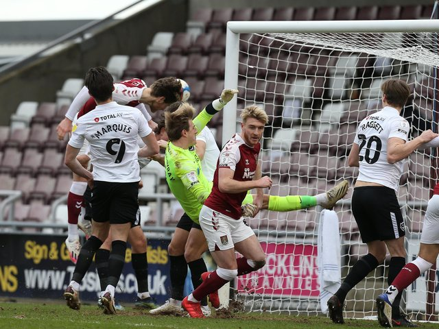 NORTHAMPTON, ENGLAND - MARCH 06: Fraser Horsfall of Northampton Town scores his sides third goal during the Sky Bet League One match between Northampton Town and Portsmouth at PTS Academy Stadium on March 06, 2021 in Northampton, England. (Photo by Pete Norton/Getty Images)