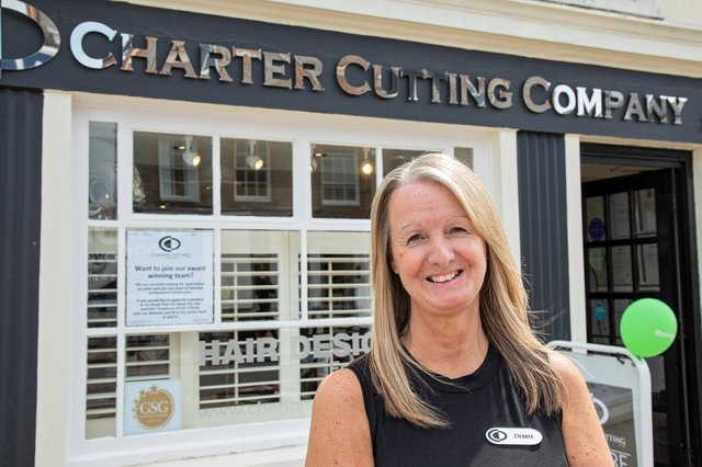 Debbie Hulbert (59) from The Charter Cutting Company in Emsworth celebrates her 36th anniversary by holding a fundraising day for Rowan's Hospice. Picture: Mike Cooter (240621)
