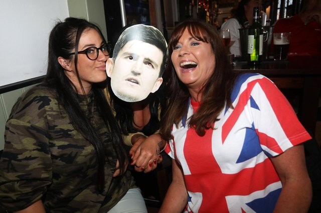 England fans pictured at the Milton Arms in Portsmouth, UK, about to watch England play on TV in the Semi-finals at Wembley. Pictured is from left, Chaz Mercer, Kate Davis and Karen Mercer-Wake. Picture: Sam Stephenson