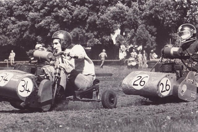 Lawnmower drivers race against each other during the Portsmouth Lawnmower Grand Prix, held at St James Hospital, Milton on July 27 1980. The News PP3706