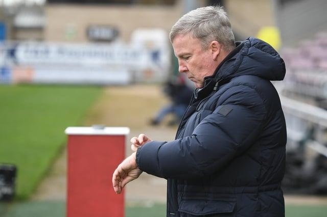 Pompey boss Kenny Jackett checks his watch at Northampton on Saturday.