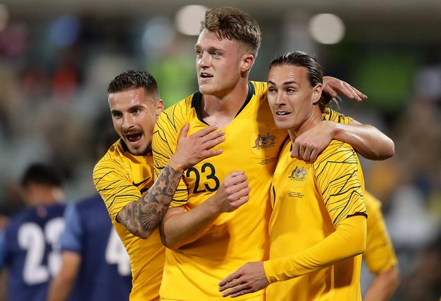 Harry Souttar, centre, playing for Australia