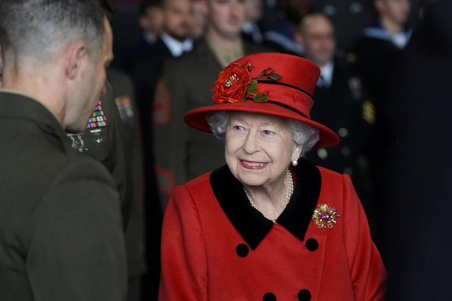 Queen Elizabeth II talks to military personnel during a visit to HMS Queen Elizabeth at HM Naval Base, Portsmouth, ahead of the ship's maiden deployment. The visit comes as HMS Queen Elizabeth prepares to lead the UK Carrier Strike Group on a 28-week operational deployment travelling over 26,000 nautical miles from the Mediterranean to the Philippine Sea. Picture: Steve Parsons/PA Wire