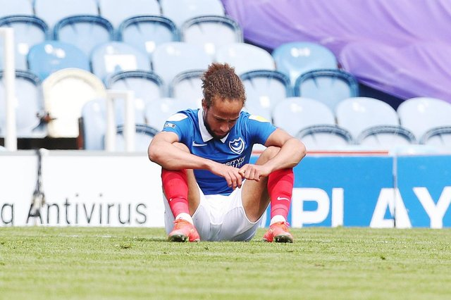 Marcus Harness dejected after Pompey failed to make the League One play-offs following defeat to Accrington. picture: Joe Pepler