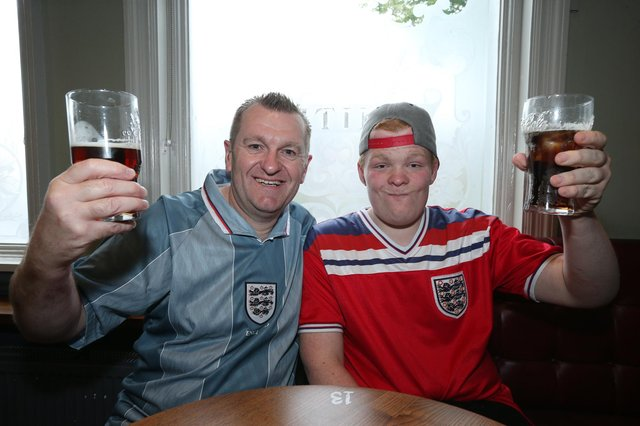 Pete Hayden and his son, Zach. Fans watch England v Czech Reublic in England's third Group D game of Euro 2020, in The Star & Garter pub, Copnor, Portsmouth. Picture: Chris Moorhouse (jpns 220621-16)